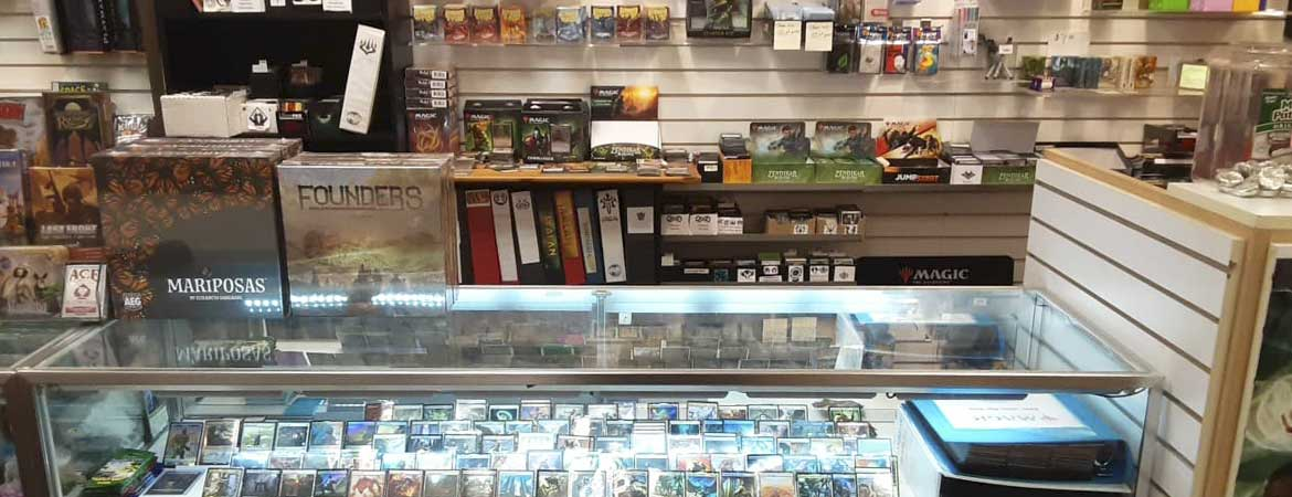 lit display case with magic the gathering singles
